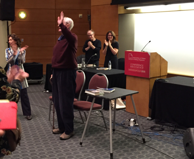 Robert Bly waves to the crowd at AWP after his reading on Saturday.