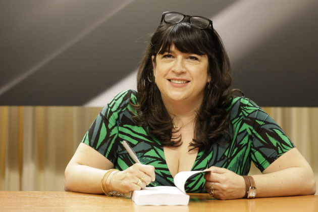 "E.L. James, signing copies of ""Grey."" Associated Press photo by Mary Altaffer"