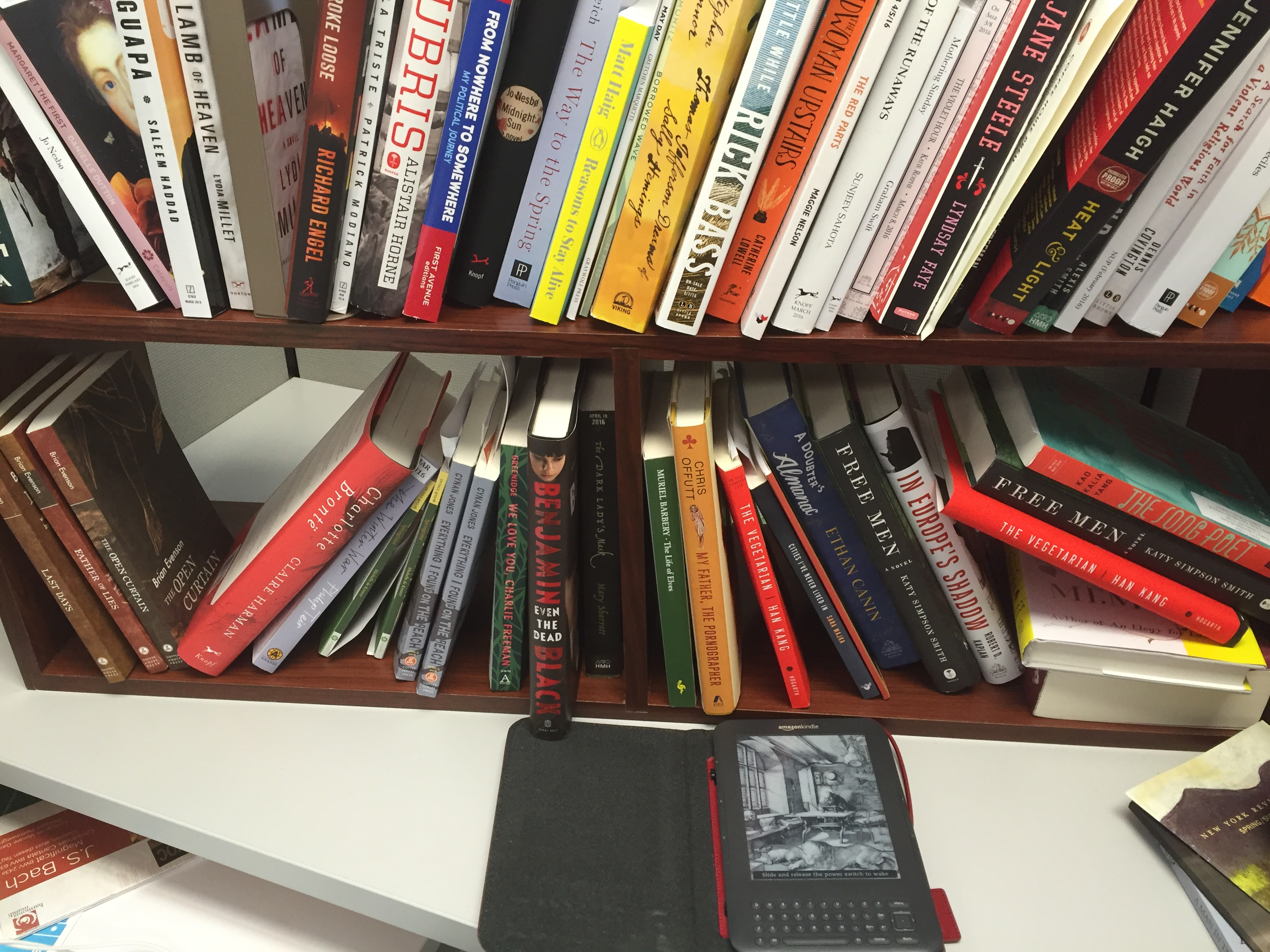 At the books editor's desk: A Kindle, and advance copies of books.