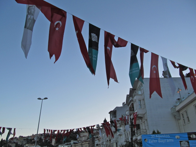 Turkish flags strung alongside the houses on the Bosphorus Strait.