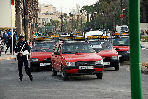 A fleet of Moroccan taxis, none of which will give you a ride.
