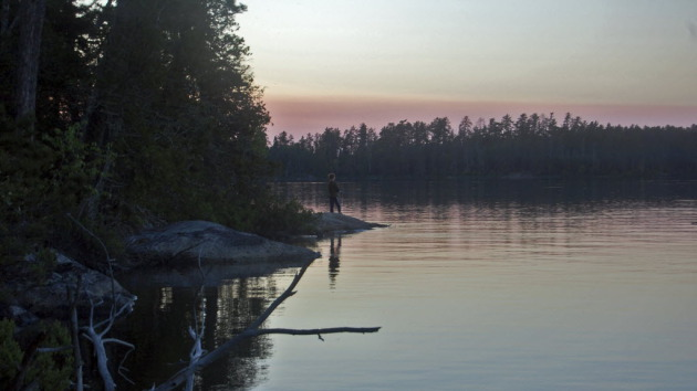 A boy fishes on Saganaga Lake in the Boundary Waters Canoe Area