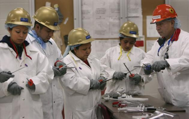 Workers at a meat processing plant in Worthington, Minn., where the Hispanic population jumped in the latest Census reports.