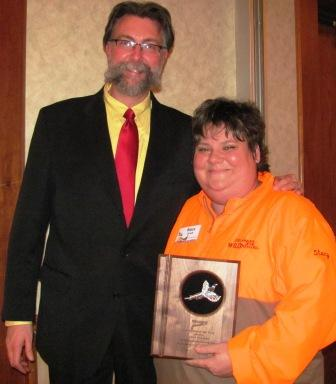Stacy Dvorak receives the Minnesota Pheasants Forever Volunteer of the Year Award from Scott Roemhildt, Pheasants Forever Regional Representative.