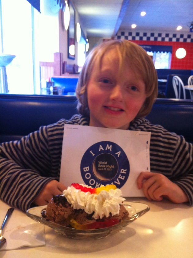 Milo Amundsen gets a sweet reward after an afternoon of giving books.