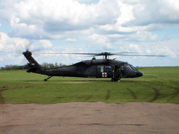 A UH-60 Black Hawk helicopter, above, and a MD 500E, below.