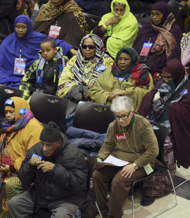 Incumbent Rep. Phyllis Kahn sat near supporters of her caucus opponent Mohamud Noor during a rescheduled caucus held Wednesday. PHOTO BY RENEE JONES SCHNEIDER