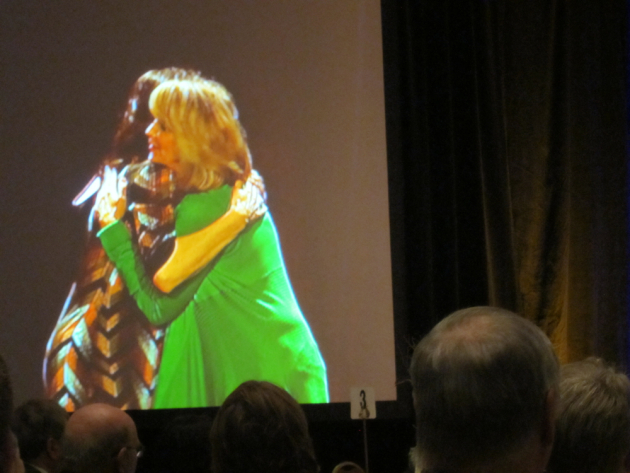 Lorna Landvik and Louise Erdrich embrace after Erdrich receives the Minnesota Book Award for fiction.
