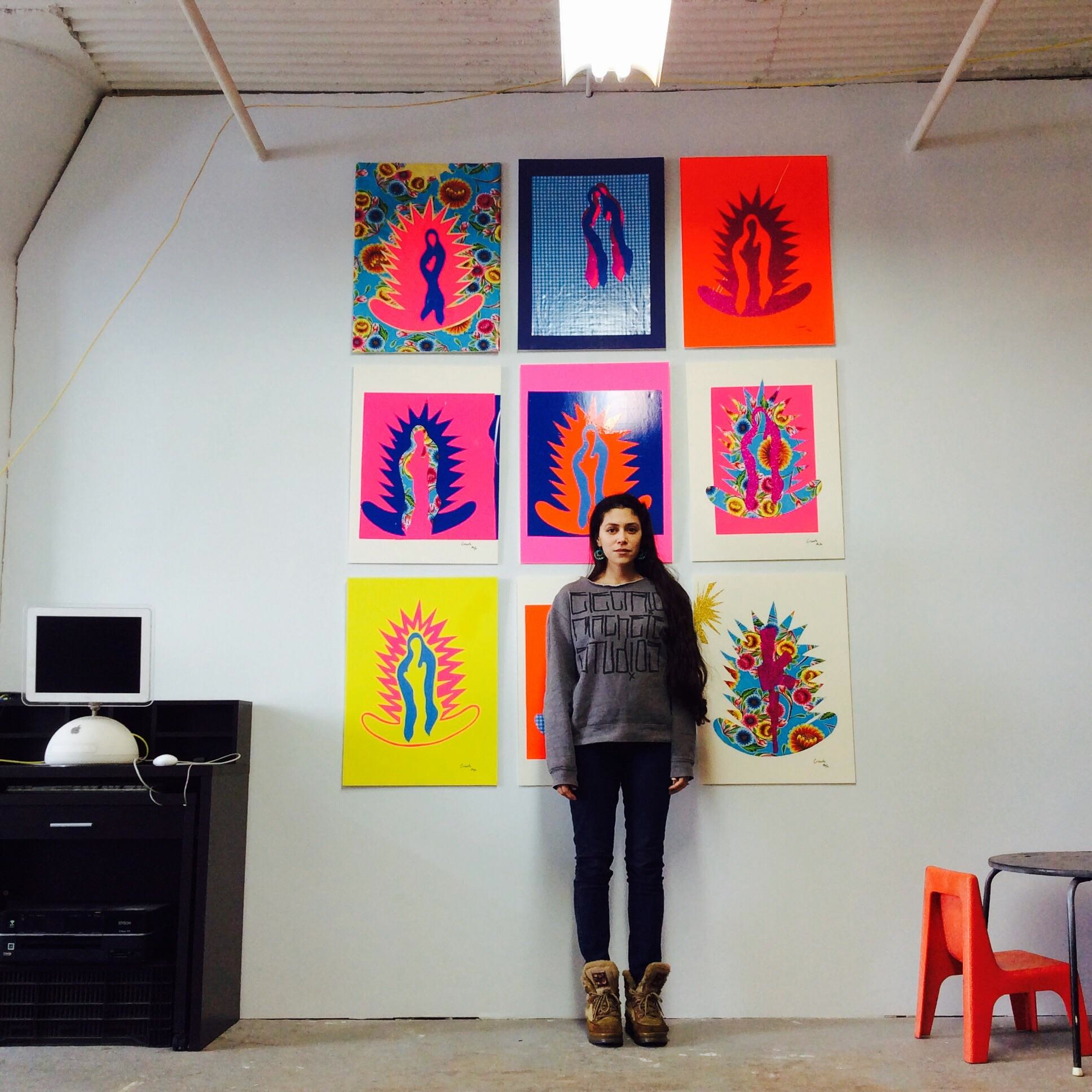 Post-modern folk expressionist Rebekah Crisanta in front of her M-Series at Electric Machete Studios.