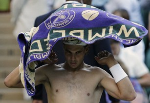 Too hot for a shirt? Rafael Nadal thought so. Also too hot for a victory; he was bounced at Wimbledon. /AP Photo