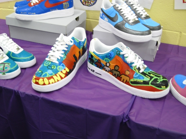 "For the YMCA's ""Remix your Kicks"" project, youth designed and painted sneakers to represent how they see peace in the city."
