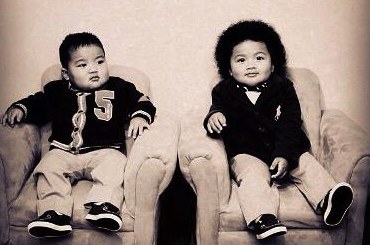 MarZell, left, and MarShawn Gray, 1-year-old sons of Gopher senior MarQueis Gray