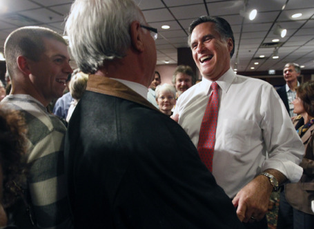 Mitt Romney with a fan at a Monday <a href=