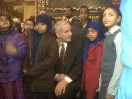 Gov. Mark Dayton with kids after a bill signing ceremony