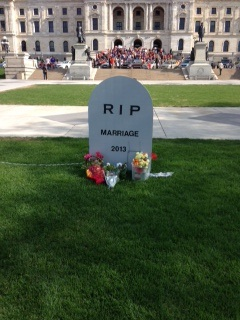 Don Lee set up a gravestone in front of the Capitol to greet the expected approval of same-sex marriage