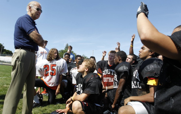 Biden visited with the South High football team in 2012 during a visit to the state