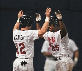 Todd Walker and Alex Ochoa, showing off their synchronized home plate routine