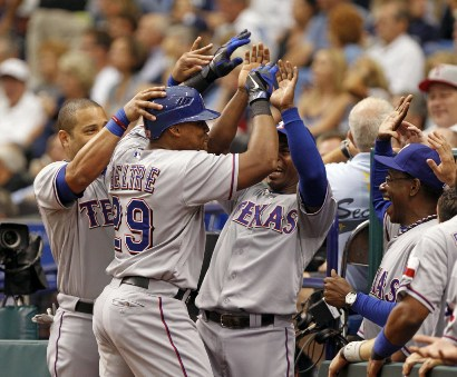 Adrian Beltre is congratulated after the second of his three home runs (so far) Tuesday. /Lynne Sladky, Associated Press