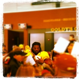 Starting QB MarQueis Gray signs autographs after the game in the concourse.