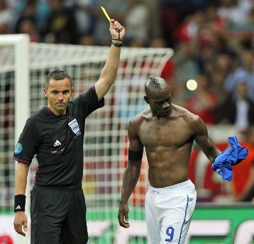 Mario Balotelli took his shirt off after his second goal and got a yellow card, but it was totally worth it. /AP Photo
