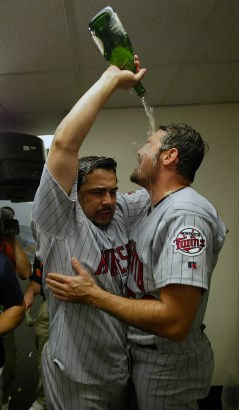 Tony Fiore and Eddie Guardado share a moment after the Game 5 ALDS win vs. Oakland in 2002
