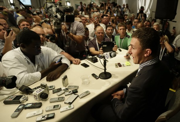 Here is Johnny Manziel at his sentencing ... er, SEC Media Day