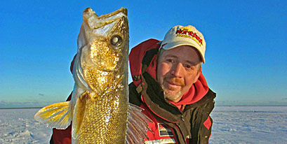 Tim Schwartz of H2O Outfitters in Big Lake with a chunky Mille Lacs walleye he caught guiding with Roach's Guide Service