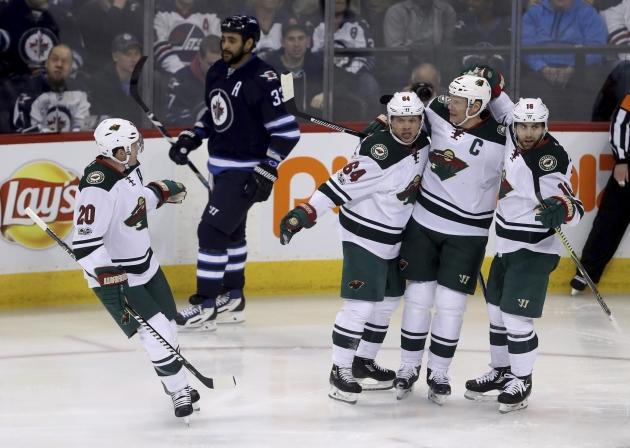Dumba scores twice in third as Wild beat Jets 4-1