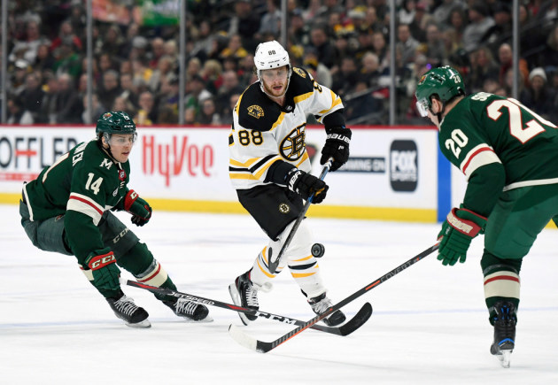 Krug's four points boost Bruins in win against Wild