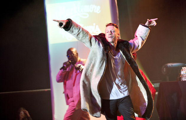 Macklemore performing in a fan's coat Friday at First Avenue.