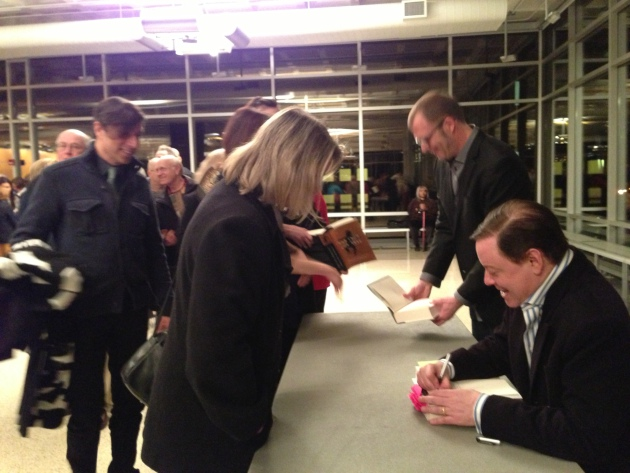 A long line snaked through the Hill Ballroom at Macalester during Andrew Solomon's book-signing.