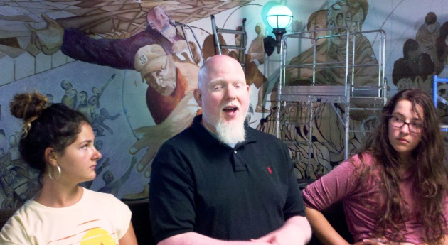 Rapper Brother Ali, portrayed in the mural (background) spoke with South students about his democratic activism    Staff photos by Steve Brandt
