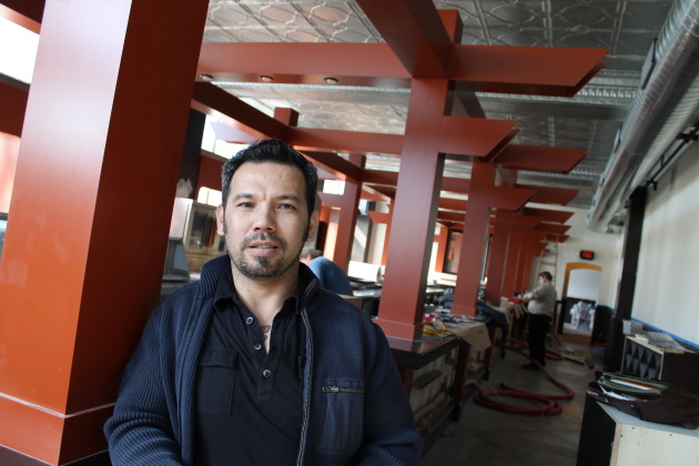 Thom Pham showed off the new bar at Azia Market. Photo by Tom Horgen.