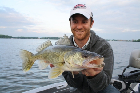 Travis Frank proudly holds a dandy metro walleye from the first week of the 2010 season.