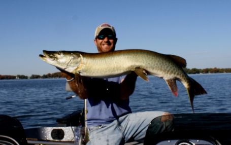 Travis Frank hoists a 50 inch muskie caught during the 2010 season.
