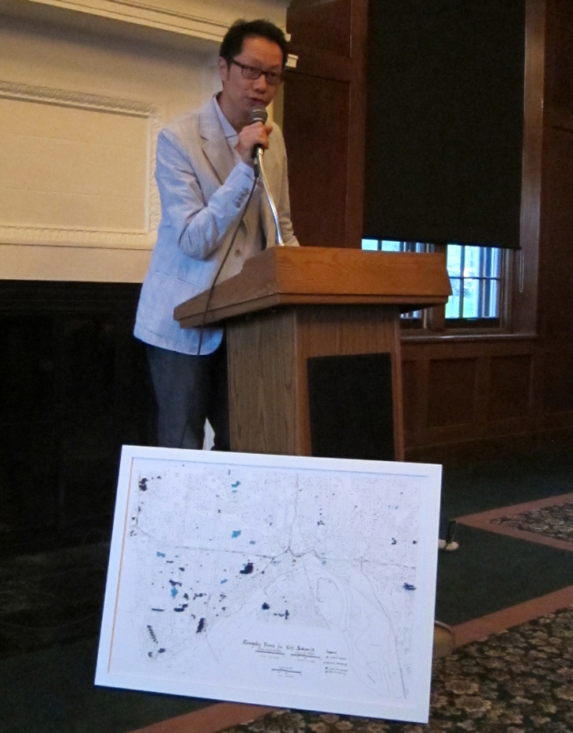 Marcus Young, with a map of where all the sidewalk poems are in St. Paul.