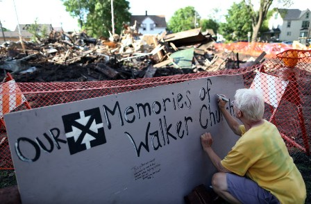 On Monday, Rich Deming signed a board of memories of Walker Community ...