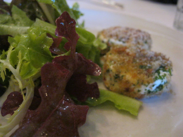 Baked Adante Dairy goat cheese with garden lettuces