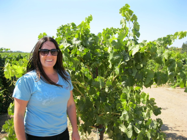 Foppiano winemaker, Natalie West, in front of Petite Sirah vines. 